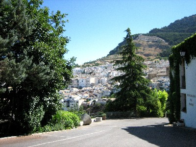 All of the buildings in Cazorla are white, and the town wraps around the sides of several hills.