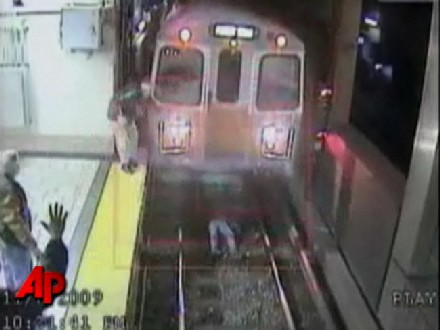 In this image made from a Friday, Nov. 6, 2009 surveillance video provided by the Massachusetts Bay Transportation Authority, a subway train comes to a stop just before running over an unidentified woman who fell on the tracks at Boston's North Station. The woman suffered some scrapes and was taken to a hospital for evaluation. She told authorities she had been drinking. (AP Photo/Massachusetts Bay Transportation Authority via AP Television Network)