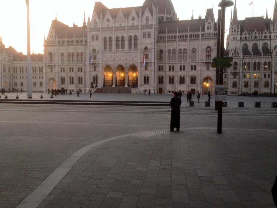 Marjorie stands before Parliament.