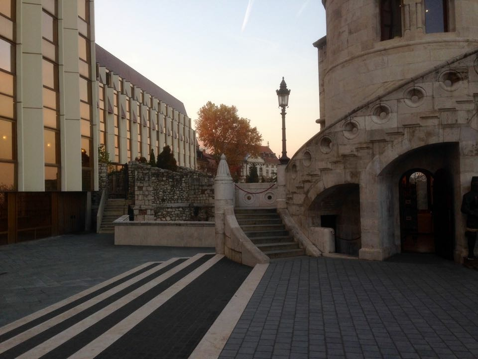 Another view from inside the castle's courtyard, looking at stairs leading to a tower.