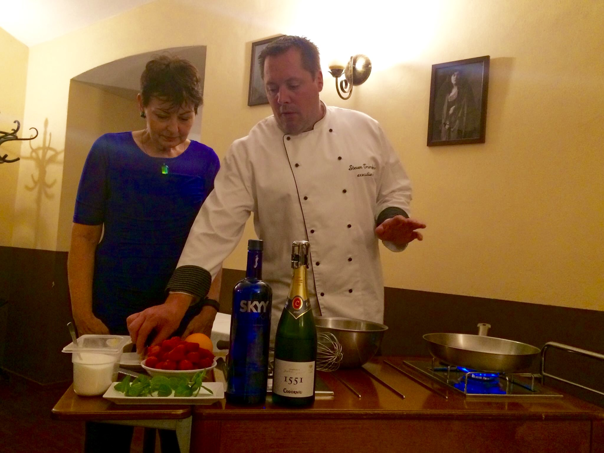 "And of course, there is Steven, head chef and owner at U Emy Destinnové, where Patience also works. Here Steven is giving the Reverend Mother some cooking tips:""This is what we call a strawberry."""
